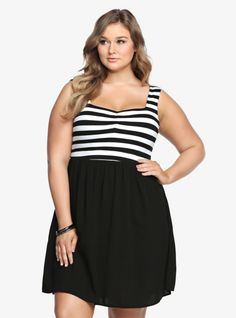 This contemporary dress has our full attention. The black and white striped bodice is the picture-perfect complement to the black skirt. It has a soft cotton top mixed with a free-flowing challis bottom. A slightly shirred sweetheart neckline finishes off this look with sexy detail.
