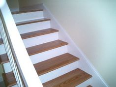 update the stairs with white risers until we can refinish floors.