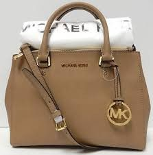 Micheal Kors medium leather satchel.Clean lines combined with soft pebbled leather makes for a perfect overall design.