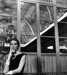 French actress and model Capucine (Germaine Lefebvre) posing in a hotel wearing a Givenchy dress.