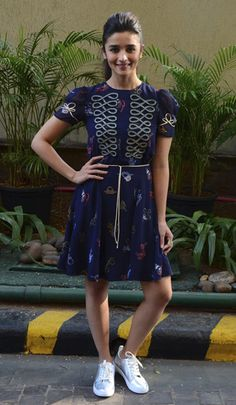 Alia Bhatt in a TommyXGigi dress and Clarks sneakers.