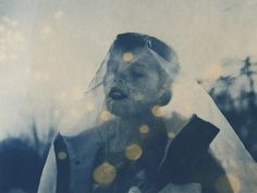 "Daniel W. Coburn. ""Asphyxiation."" (2014). Digital negative toned cyanotype. Coburn used the process of digital negative in which photographers are able to convert digital files to negatives on transparency film.  From there, Coburn is able to manipulate the digital image in the darkroom using various processes such as cyanotype as seen here.  I really like the coloring and spotting on this image. It gives a uniquely vintage look to an image that began digitally."