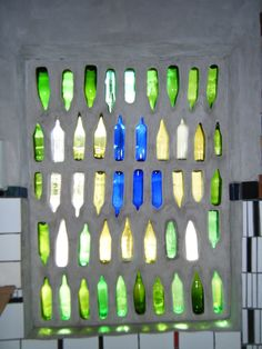 Hundertwasser: Bathroom window with colored glass bottles. Super cool!