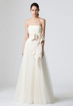 If Your Wedding Dress Is: a Strapless A-Line Brides adore strapless A-line wedding dresses for a reason: The shape is forgiving on the bottom half while showing off a sexy décolletage. Emphasize the nipped-in waist by toning your oblique muscles (a.k.a. the sides of your abs) with this two-part move that tones your shoulders too.   Vera Wang Delany dress, verawang.com for stores