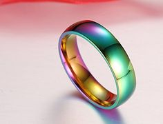 The perfect gift for your boyfriend orgirlfriend. This is a beautiful rainbow shimmering metallic gay pride ring. Wear thegorgeous gay stainless steel ring with pride, gay pride that is. Not only a fashion statement, but also goes with every outfit you can imagine.