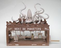 Wooden automata by Wanda Sowry awesome giant squid ,octopus mechanical toy with little fish that rise up and down on the moving mechanics adding to the fun...here be monsters worth bumping into from this clever mechanical automata toy artist