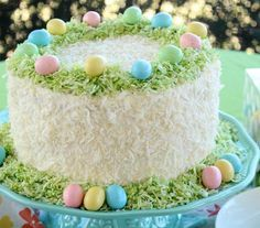 Easter Lemon Coconut Cream Cake - Coconut and lemon pair together beautifully for a delicious Easter dessert. Add colored coconut for a festive look that is perfect for any holiday or occasion. The lemon cake with coconut pastry cream is topped with coconut frosting for a yummy recipe that is also gorgeous.