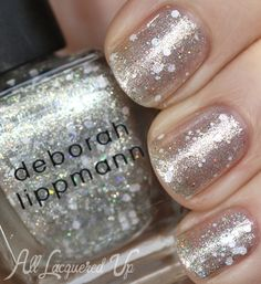 Deborah Lippmann Space Oddity Trio for Holiday 2013 – Nail Polish Swatches  // Deborah Lippmann When Lightening Strikes has a silvery sheer base that looks very icy on the nail. It's packed with mini holographic glitter particles, that resemble multi-colored twinkle lights, and white hexagonal glitter in multiple sizes. It gives Planet Rock a frosted appearance when layered over top.