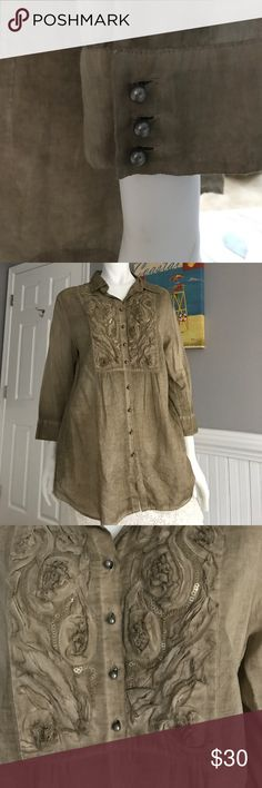 """Beautiful Tunic Blouse This really is pretty & unusual. Olive colored with incredible detail such as raised rosettes, subtle shimmering sequins. Round little gunmetal colored buttons @ true tailoring craftsmanship. Bought in a European boutique on vacation. The Dutch size is 44 and translates to a US size 6 , I am a medium & this fit great but would easily accommodate sizes 4-8. This brand """"public"""" is a high-end European brand and not available in the US. Flawless, never worn,which is a…"""