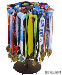 A new way to display that bling...no screws necessary! Premier Tabletop Race Medal Display exclusively from: