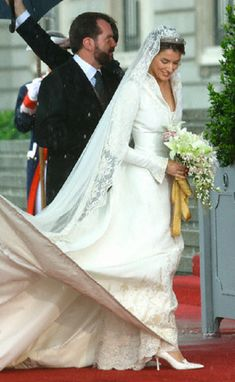 Letizia Ortiz and her father arrive at her Wedding Ceremony at Almudena Cathedral in Madrid