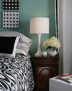 How do you like turquoise with black and white??  I think it is real pretty.  This isn't a good shade, maybe a little brighter?  Also I love the squares of canvas covered with different black and white prints.  This would look cool on a wall.