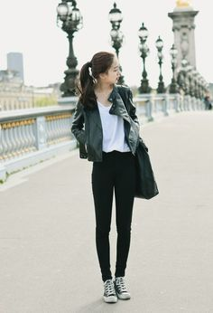 Wear a black leather biker jacket and black slim jeans to create a chic, glamorous look. Black and white canvas high top sneakers will contrast beautifully against the rest of the look.   Shop this look on Lookastic: https://lookastic.com/women/looks/biker-jacket-crew-neck-t-shirt-skinny-jeans/18215   — White Crew-neck T-shirt  — Black Leather Biker Jacket  — Black Leather Tote Bag  — Black Skinny Jeans  — Black and White Canvas High Top Sneakers