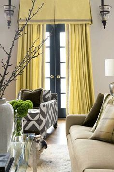 Going from floor to ceiling with your window treatments will make a room appear taller. Dont stop at the top of the window. In this case the valance goes well above the top of the French doors.