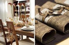 Decoração de Natal. Mesa de natal decorada. Flores como centro de mesa. Enfeites na cadeira. Cores elegantes como o dourado e o cobre.
