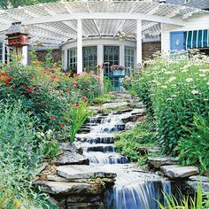 Use the natural slope of a backyard for a relaxing waterfall! See more dream water gardens: http://www.bhg.com/gardening/landscaping-projects/water-gardens/dream-water-gardens/?socsrc=bhgpin042513waterfallgarden=6