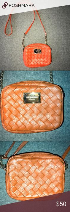Michael Kors Orange BRAIDED Leather crossbody Small crossbody. Gently used. No stains. 4 credit card slots inside one additional slot on opposite side. Gold accents. 7 inches wide, 2 inches across and 5 inch height. Fits my iPhone 8 Plus. Gold emblem on front has a few scratches.  Genuine leather.  NO TRADES- thank you. MICHAEL Michael Kors Bags Crossbody Bags