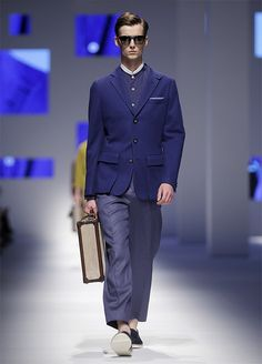 A model wears a creation for Canali men's Spring-Summer 2016 collection, part of the Milan Fashion Week, unveiled in Milan, Italy, Monday, June 22, 2015. (AP Photo/Antonio Calanni)