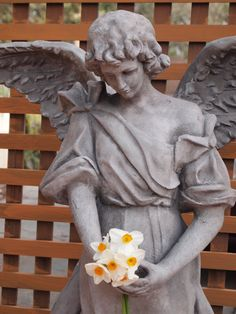 Daffodils for a garden angel. By Paulette Avery of  Moraga