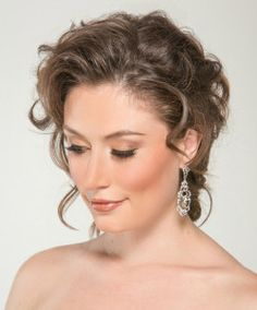 Romantic bridal hair and makeup.  Soft textured curly updo with golden bronze makeup by Hair Comes the Bride.  Perfect for a bride, bridesmaid, mother of the bride or special occasion.