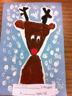 We did a reindeer directed drawing. First in pencil then we outlined in black crayon. Then they painted the reindeer. They used their fingerprints to make the snow. Then they measured how tall their reindeer was using cubes