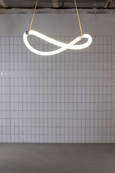 This lighting collection uses a flexible LED loop hidden within a woven textile