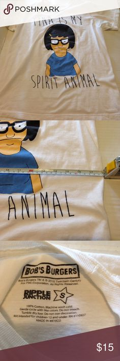 Bob's Burger Tina is my Spirit Animal T-Shirt We all know Tina is the epitome of awesome. This shirt was made by Ripple Junction. It is a size small. It's length across while it is flat, is 18 inches. If you look on Ripple Junction's website you will see this shirt is carried in a men's fit type and a women's fit type. Based on the collar, I would say this is more of the men's fit type. Ripple Junction Tops Tees - Short Sleeve