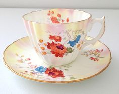 Beautifully sparse and exquisite in its majesty…..This sumptuous tea cup and saucer makes for a very elegant display. Whether you are looking to add to a fine collection, or to give as a special gift, this set is guaranteed to please. Measures Approximately: Cup: 2 3/4 tall x 4 1/2 wide (includes handle); Saucer: 5 1/2 diameter    Shop with confidence.    Please note that I offer vintage one-of-a-kind items that embrace romance and a time worn appeal. While most of my items hav...