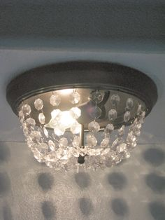 We all have those blasted boob lights. I have 4 that I wanted to replace, but with my low ceilings, I needed something close to the ce...
