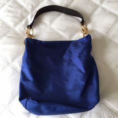 JPK Paris 75 Hobo Nylon Bucket Bag Great condition inside and out. Very spacious with plenty of inside compartments - 2 large zipper pockets, 2 side snap pockets, and 1 main snap pocket. Inside lining is a beautiful floral print with green, blue and purple. Shoulder strap is brown leather, gold hardware. JPK Bags Shoulder Bags