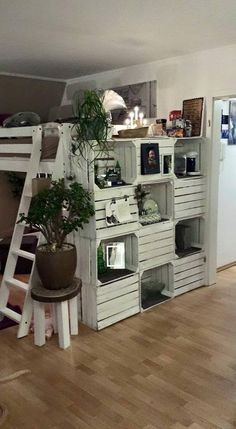 I Love the Crate Wall. It creates wall space and shelving in both sides. Brilliant.