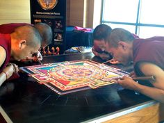 Wednesday, end of Day 3 of Tibet Week as part of Emory-Tibet Partnership. Four monks from Drepung Loseling Monastery work on the mandala - it will take 25-30 hours of work by up to four monks at a time to complete this mandala by Saturday.