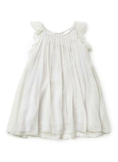 100% Silk Dress. Lightly crinkled silk chiffon dress, cut in a breezy shift silhouette. Halter neckline, with light frill along armhole. Zip opening at back with snap closure. Fully lined in 100% cotton. Features all-over silver spot. Available in Dove Grey.