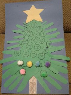 This is a fun, simple advent calendar made with construction paper, glue and pom poms. Simply trace both hands of each family member on green construction paper, cut them out and place them from smallest to largest in a Christmas tree shape on another piece of construction paper or posterboard. Draw and number 25 circles (I traced the cap from a soda bottle). Glue a pom pom to one circle each day from Dec. 1 until Christmas Day to decorate the tree!