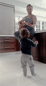 Tom playing the guitar. Draco Malfoy learning to play a muggle contraption to impress his already impressed wife.