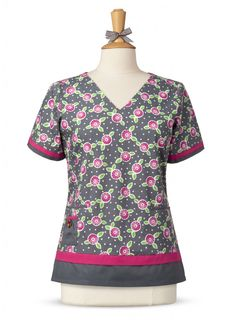 Mary Engelbreit's print scrub top incorporates a mix of prints and solids into one spectacular looking scrub top. The layered hemline and sleeve detail make this scrub top different than everything else! Thhis print scrub top has a v-neckline front darts to add shape and side vents to make it easier to move throughout your busy day. This ME top has two large front pockets, an accessory pocket & a detachable ME flower applique. 100% cotton.  On sale now at Scrubs & More, The Uniform Store.