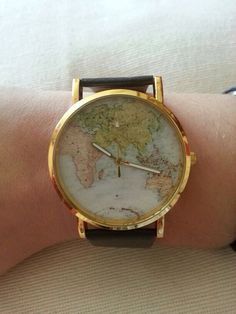 Map atlas watch on a brown strap on Etsy, $11.91
