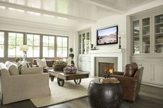 family room cabinets (would want without glass doors on cabinets though) and fireplace mantle with TV above