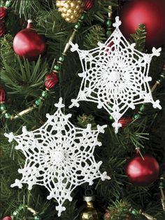 Delicate Snowflakes Crochet Pattern Download from e-PatternsCentral.com -- Delicate ribbon roses embellish the center of each of these ethereal snowflake ornaments. You'll want to make dozens to hang on your tree or in your windows.