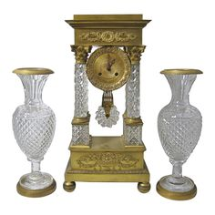 For Sale on - French Empire clock garniture with gilt bronze and Baccarat crystal. An important French Baccarat cut-crystal and ormolu mantel clock with four Corinthian Modern Mantel Clocks, Vintage Mantel Clocks, Modern Clock, Antique Clocks, Pendulum Clock, Retro Clock, Baccarat Crystal, Clocks For Sale, French Empire