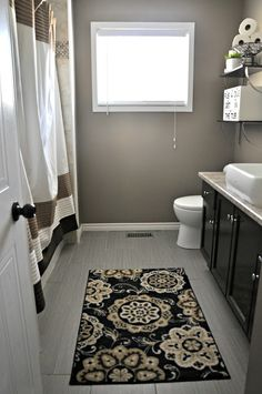 i love this bathroom makeover and we even have that same shower curtain!