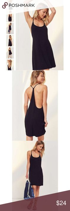 """NWT Silence+Noise Racerback Dress New With Tags. Never before tried on and in manufacturer's original packaging. The essential ribbed knit racerback dress. Supremely soft & stretchy ribbed knit in relaxed shift silhouette. Topped with a deep scoop neck and open sides. Finished with an oh-so low thin racerback. Rayon/Spandex. Model 5'9"""" wearing size S. ✔Great bundle discounts. Urban Outfitters Dresses Mini"""