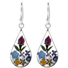 Charmingly unique, pressed flower jewelry is handcrafted from real flowers and is preserved in a clear resin surrounded by .925 silver.  The nature of flowers provides a one-of-a-kind look to each piece and the image may show a slight difference to the actual flowers in color and composition. Only $39.00!