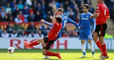 Second-half goals from Andre Schurrle and Fernando Torres saw the Blues come from behind to end the season with a 2-1 win at Cardiff City...