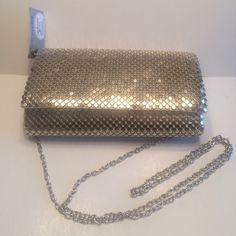 """New Jessica McClintock evening bag New with tags,light gold metal mesh evening bag. Very light gold color, with silver tone shoulder strap. 7.75""""W X 4.5""""H. 21"""" shoulder drop Jessica McClintock Bags"""