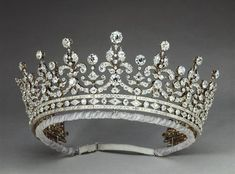 Queen Elizabeth still wears this beauty frequently today. It came from Princess Victoria Mary of Teck (later Queen Mary), who received The Girls of Great Britain Tiara as a wedding present; she once wore it to an 1897 ball to complement her French. Royal Crowns, Royal Tiaras, Crown Royal, Tiaras And Crowns, Queen Mary, Queen Elizabeth, Elisabeth Ii, Diamond Tiara, Family Jewels