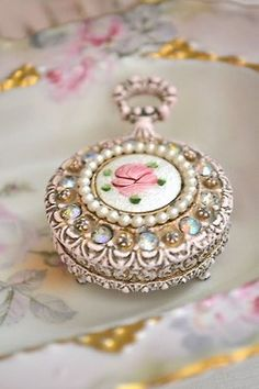 Not sure if this is a watch pendant or a locket but it is just dainty and gorgeous!