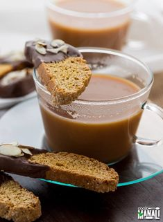Crispy and crunchy Pumpkin Biscotti dipped in chocolate - perfect for fall mornings with a cup of coffee!