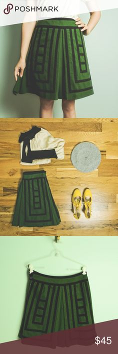 """Anthropologie Tsuga Skirt by Maeve SZ. 4 One of my very favorite Anthro pieces of all time!! I originally bought this size, which was the last one available but then purchased a size smaller later on. Beautiful green wool with contrasting black windowpane trim. Flattering A-line shape with kick pleats. Worn once and purchased off a mannequin with missing metal clasp. Easily repaired. Perfect for Fall and winter with tights and tall boots or pumps! My measurements: waist 26-27"""", hips 34""""…"""