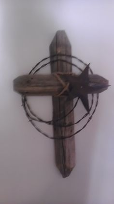 Western Cross, barb wire and made out of old fence post. $40